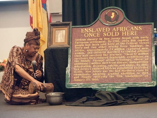 International Storyteller, Queen Nur, (CQ) recites a story during  the unveiling of a monument recognizing New JerseyÕs slave trade. The event took place at the Rutgers Camden University, Walt Whitman Building.