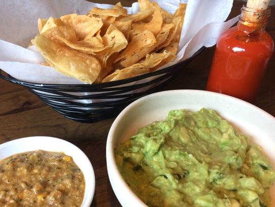 "Basket of hot salty chips with habanero ""Kreeper"" salsa,"