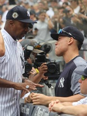Former yankee third base coach Willie Randolph talks with Aaron Judge on the bench before today's game.