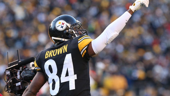 Pittsburgh Steelers wide receiver Antonio Brown (84) celebrates after scoring a touchdown during the fourth quarter against the Jacksonville Jaguars in the AFC Divisional Playoff game at Heinz Field.