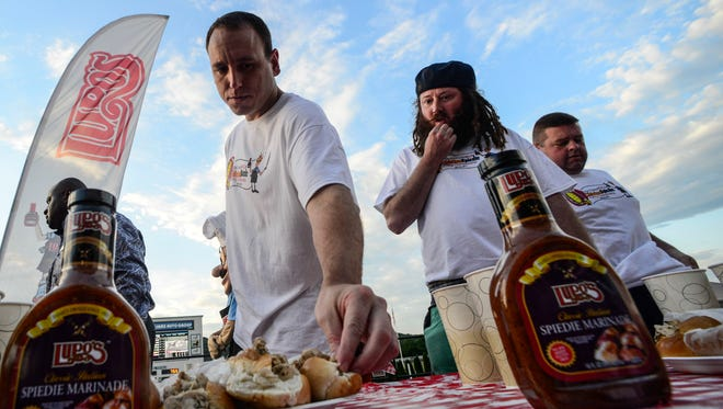 Joey Chestnut prepares himself before the start of the Major League Eating-sanctioned spiedie-eating contest held at Tioga Downs in 2014.