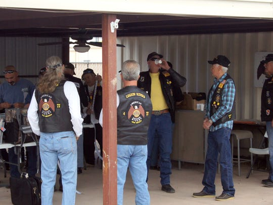Members of the American Legion Riders, Chapter 12, congregate in the American Legion Bataan Post 4 patio prior to the start of the Forgotten Veterans Memorial Bike Run on Saturday.