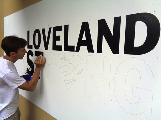 Mike Hentz paints the Loveland Strong message representing