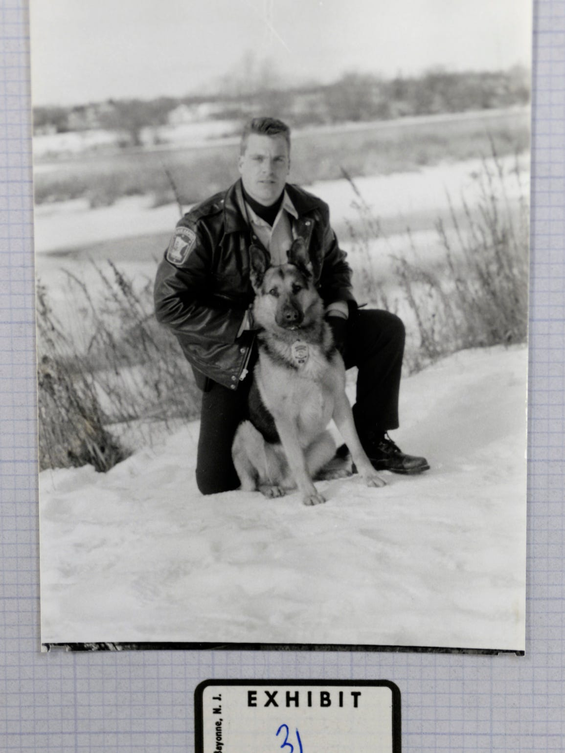 Larry Carr is shown with his K9 Rocky, who led the