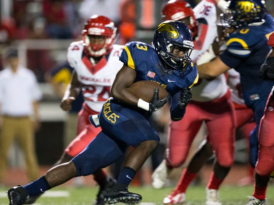 Naples' Patrick Pierre (3) carries the ball during the first half of action at Naples High School Friday, September 23, 2016 in Naples. Naples led 40-34 at the end of the first half.