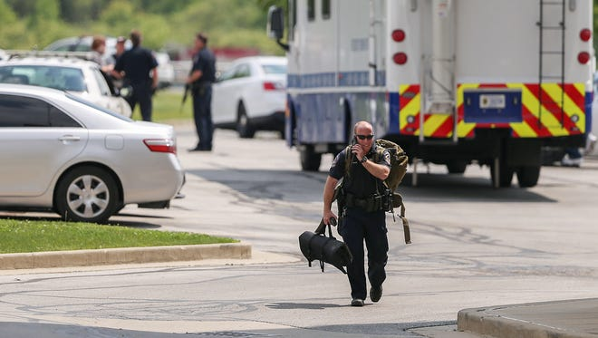 Emergency personnel respond to a S.W.A.T. involved standoff near the 4300 block of South East Street, Indianapolis, Wednesday, May 10, 2017. As of about 4:30 p.m., a wanted man was armed and barricaded in his car, according to the Indianapolis Metropolitan Police Department.