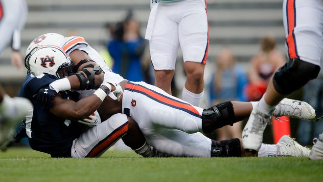 Auburn wide receiver Nate Craig-Myers (3) is tackled by Auburn defensive lineman Nick Coe (91) during the Auburn A-Day game on Saturday, April 7, 2018, in Auburn, Ala.