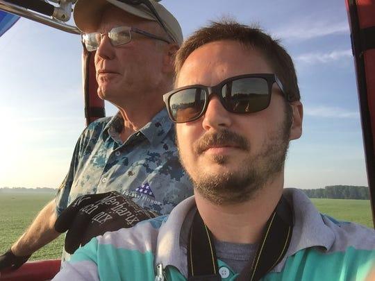 Dreamship balloon pilot Bill Baker and Enquirer reporter Nick Buckley during the Battle Creek Field of Flight Air Show and Balloon Festival.