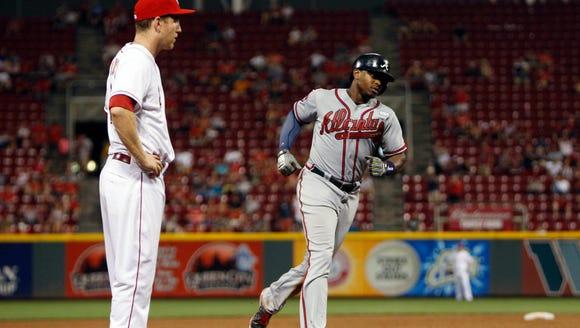 Braves left fielder Justin Upton rounds third base