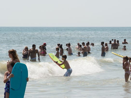 View of people on the beach near Maryland Avenue in