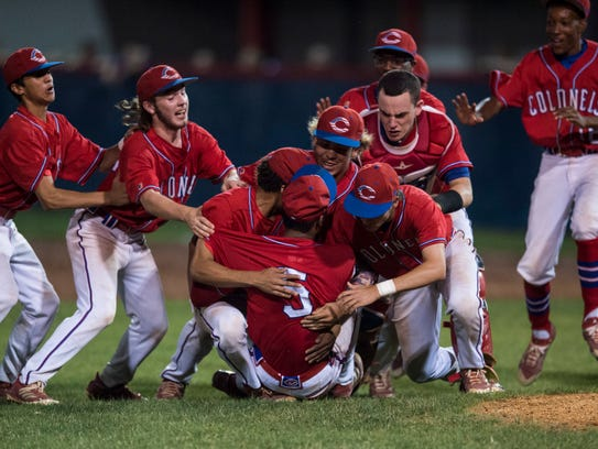 Christian County's team dog piles pitcher Lane Diuguid (5) during the Second Region final at Christian County High School on Friday, June 1, 2018. Christian County defeated Union County 6-1.
