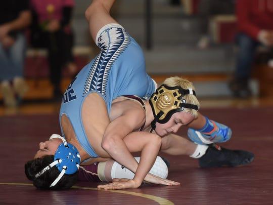 Arlington's Dennis Robin wrestles against John Jay's Marcello Bernasconi in the 99-lb. weight class.