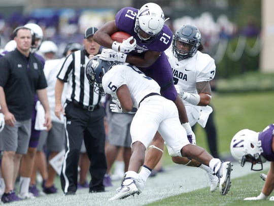 Wolf Pack defensive back Dameon Baber tackles Northwestern running back Justin Jackson during the season opener.