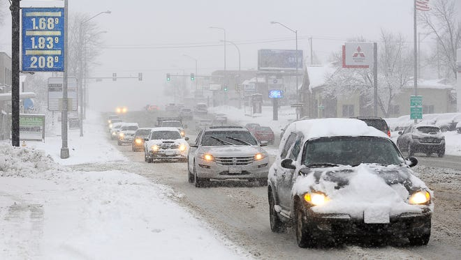 Traffic moves slowly along Minnesota Avenue near 26th Street in Sioux Falls, S.D., Friday, Jan. 8, 2016.