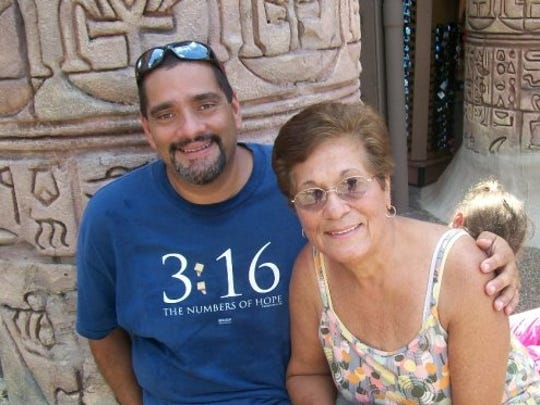 Enjoying a moment at Busch Gardens with my mother --