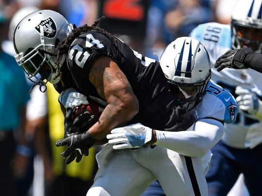 Raiders running back Marshawn Lynch (24) is tackled in the first quarter at Nissan Stadium on Sunday, Sept. 10, 2017.
