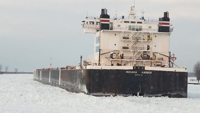 The 304-foot motor vessel Indiana Harbor sits stuck in ice in the St. Clair River awaiting to be freed on Tuesday. The U.S. Coast Guard cutter Neah Bay broke the vessel free later that day.