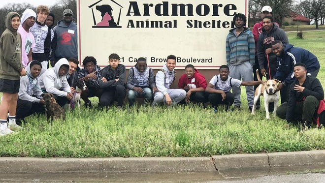 Members of Warriors for the Community after volunteering the Ardmore Animal Shelter on Saturday.