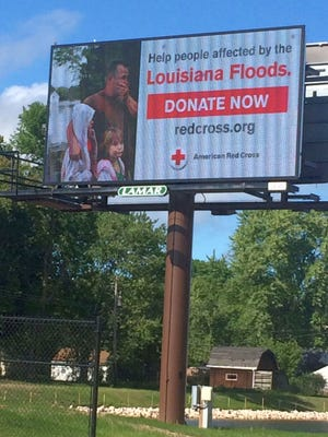 A digital billboard along Ashland Avenue in Ashwaubenon provides information for how donations can be made to the American Red Cross to support the agency's flood relief and recovery efforts in Louisiana.