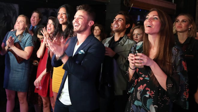 "Cast and guests applaud during the premiere of CMT's new TV show ""Music City"" February 20, 2018 at the Back Corner."