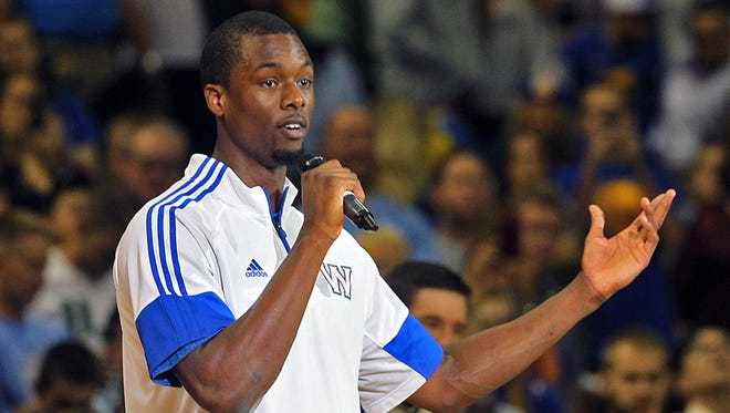 Golden State Warriors' Harrison Barnes addressed the crowd as he thanked them for attending the NBA preseason game against the Denver Nuggets at Wells Fargo Arena in Des Moines on Thursday night Oct. 16, 2014.
