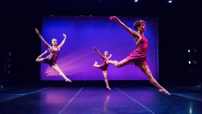 "Christal Wagner (left), Gina Laurenzi and Dani Kuepper achieve escape velocity during Danceworks Performance Company's new show, ""Dance In or Take Out?"""