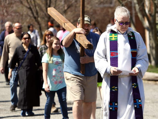Rev. Jeff Edwards of the United Methodist Church of Parsippany, leads the 'Walk with the Cross' for Good Friday started at St. GregoryÕs Church, volunteers carrying the cross along South Beverwyck Road to the United Methodist Church.  April 14, 2017, Parsippany, NJ