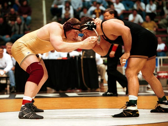 Brock Lesnar (left) during his NCAA champion career
