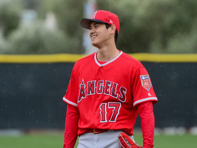 Feb. 14: Shohei Ohtani looks on in the rain during