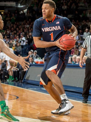 Virginia guard Justin Anderson looks to pass in the second half.