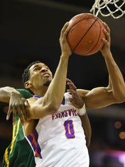 Evansville's Ryan Taylor is fouled by Norfolk State's