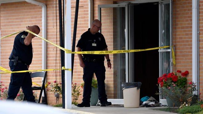 Police investigate the scene where multiple shots were fired at Burnette Chapel Church of Christ Sunday, Sept. 24, 2017 in Antioch, Tenn.