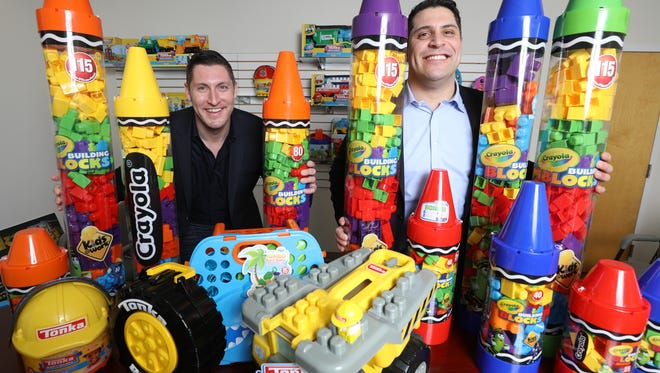 Joe and Michael Albarelli of Amloid in Cedar Knolls, a fourth generation, family run toy company founded in 1916. The brothers are shown with some of the products they will be promoting at the annual Toy Fair this week at the Javits Center in Manhattan.