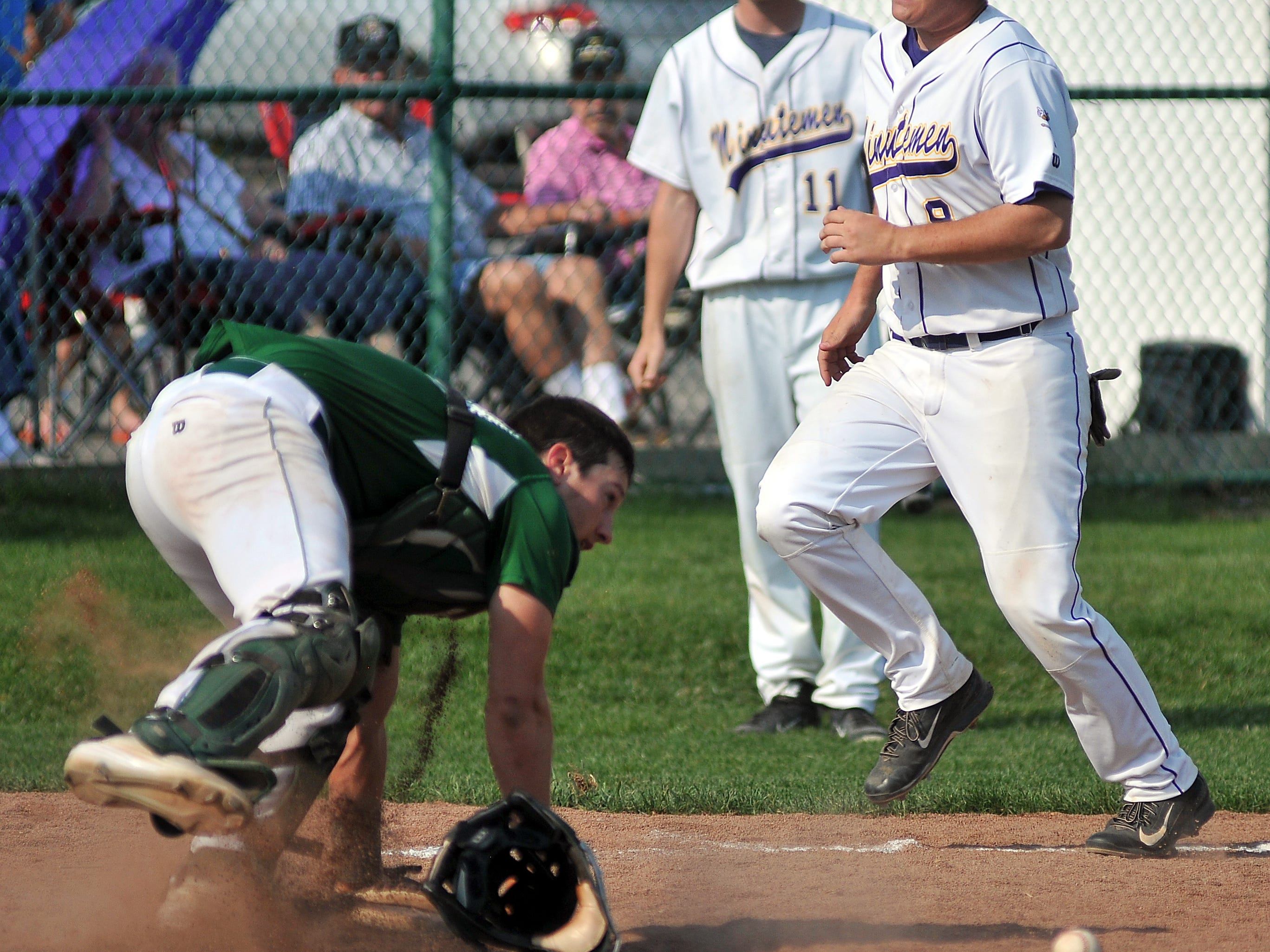 Madison's catcher can't come up with the ball as Lexington's Josh Verspoor crosses home plate for a run during their game Thursday at Lexington.