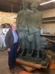 In this file photo, sculptor Garland Weeks is seen while in the process of creating a larger-than-life piece for the Veterans Memorial Plaza to be built at Lake Wichita. His bronze statue honors Vietnam War veterans.
