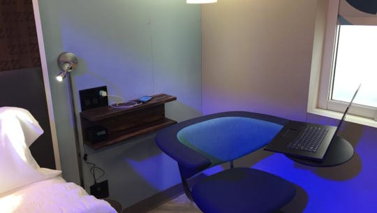 A prototype room of Hilton's new Tru brand, on display in Los Angeles, features a chair with a large armrest to place a laptop, rather than a full desk.