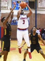 Woodlawn's Larry Moton tries to get the ball in the