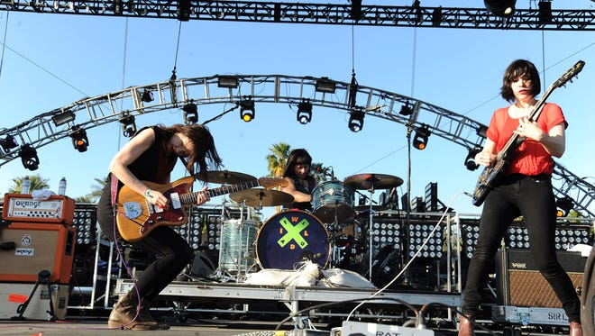 (L-R) Musicians Mary Timony, Janet Weiss and Carrie Brownstein of the band Wild Flag perform during Day 3 of the 2012 Coachella Valley Music & Arts Festival on April 15, 2012 in Indio, California.
