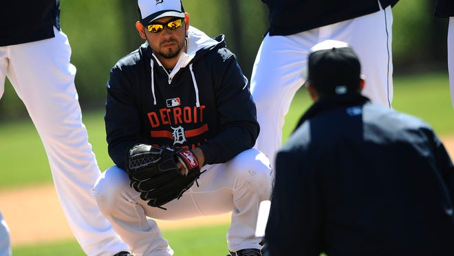 Tigers pitcher Anibal Sanchez listens to a coach as they go over signs during practice Friday.