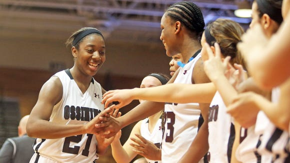 Ossining's Shadeen Samuels is congratulated by teammates after coming out of the game during the fourth quarter of a Class AA regional final against Horseheads at Marist College March 13, 2015. Samuels finished with a game high 26 points as Ossining advanced to the state final four.