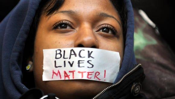 Penn State University student Zaniya Joe wears a piece