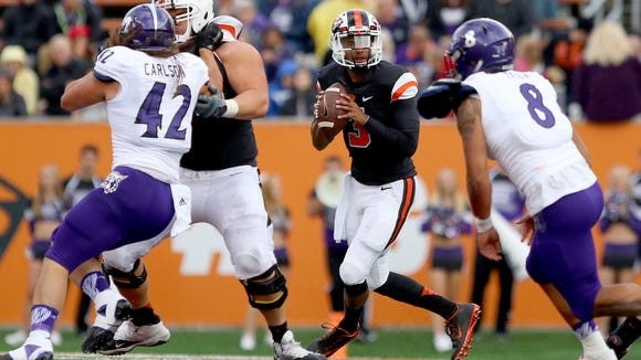Oregon State quarterback Marcus McMaryion (3) drops back to pass against Weber State during the first half at Reser Stadium, Friday, September 4, 2015, in Corvallis, Ore. The Beavers won the game 26-7.