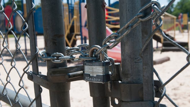 A gate to Morris Court Park in Pensacola is locked on Monday, May 15, 2017. The park has been closed since July 2016.