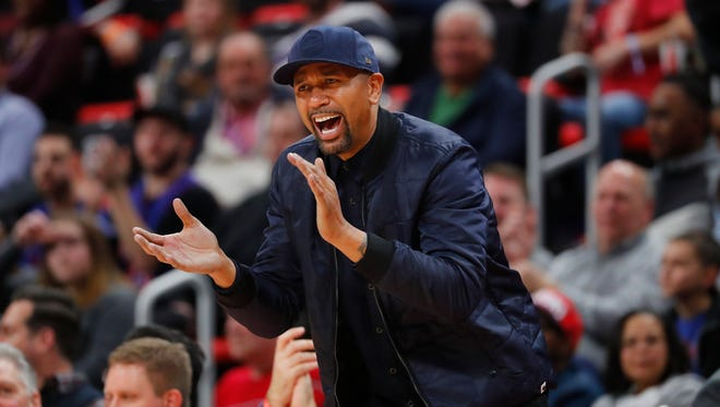 Jalen Rose cheers in the second half of an NBA basketball game between the Detroit Pistons and New Orleans Pelicans in Detroit, Monday, Feb. 12, 2018.