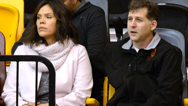From left, Santa Fe Indian School's former head boys basketball coach Ceci Moses and her husband, Rick Schimmel, attend the school's boys basketball game Tuesday, Feb. 23, 2016 in the Pueblo Pavilion at Santa Fe Indian School in Santa Fe, New Mexico. (Clyde Mueller/Santa Fe New Mexican via AP)