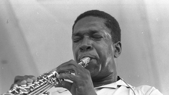 John Coltrane performs at the Newport Jazz Festival in this photo by Chester Sheard.