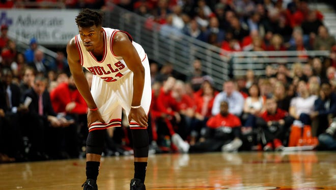 Apr 27, 2015; Chicago, IL, USA; Chicago Bulls guard Jimmy Butler (21) looks on against the Milwaukee Bucks in game five of the first round of the 2015 NBA Playoffs at United Center. The Bucks won 94-88. Mandatory Credit: Kamil Krzaczynski-USA TODAY Sports