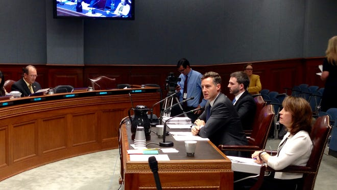 Louisiana Superintendent of Education John White (seated, center) and Deputy Superintendent Beth Scioneaux (seated, front) answers questions from members of the House Appropriations Committee about the 2015-16 executive budget for the Department of Education presented Tuesday by House Fiscal Division analyst Tim Mathis (seated, back).