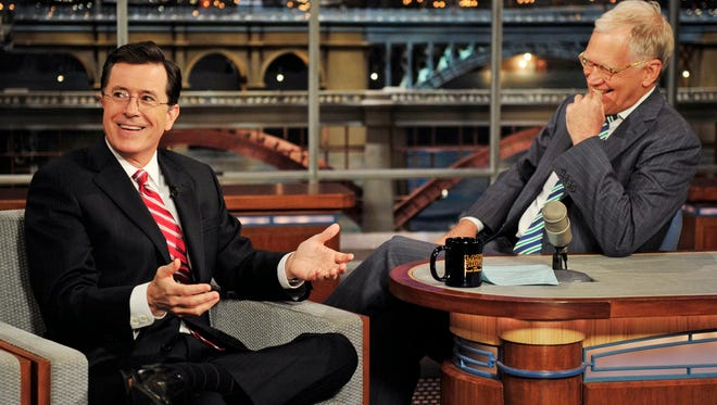 """In this May 3, 2012 photo provided by CBS, Stephen Colbert, left, host of the """"Colbert Report"""" on the Comedy Central Network, has a laugh on stage with host David Letterman on the set of the """"Late Show with David Letterman,"""" in New York. CBS announced on Thursday, April 10, 2014 that Colbert will replace Letterman as """"Late Show"""" host after Letterman retires in 2015."""