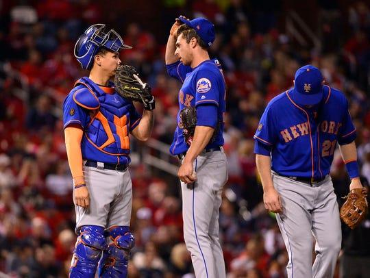 New York Mets catcher Jose Lobaton (59) talks with